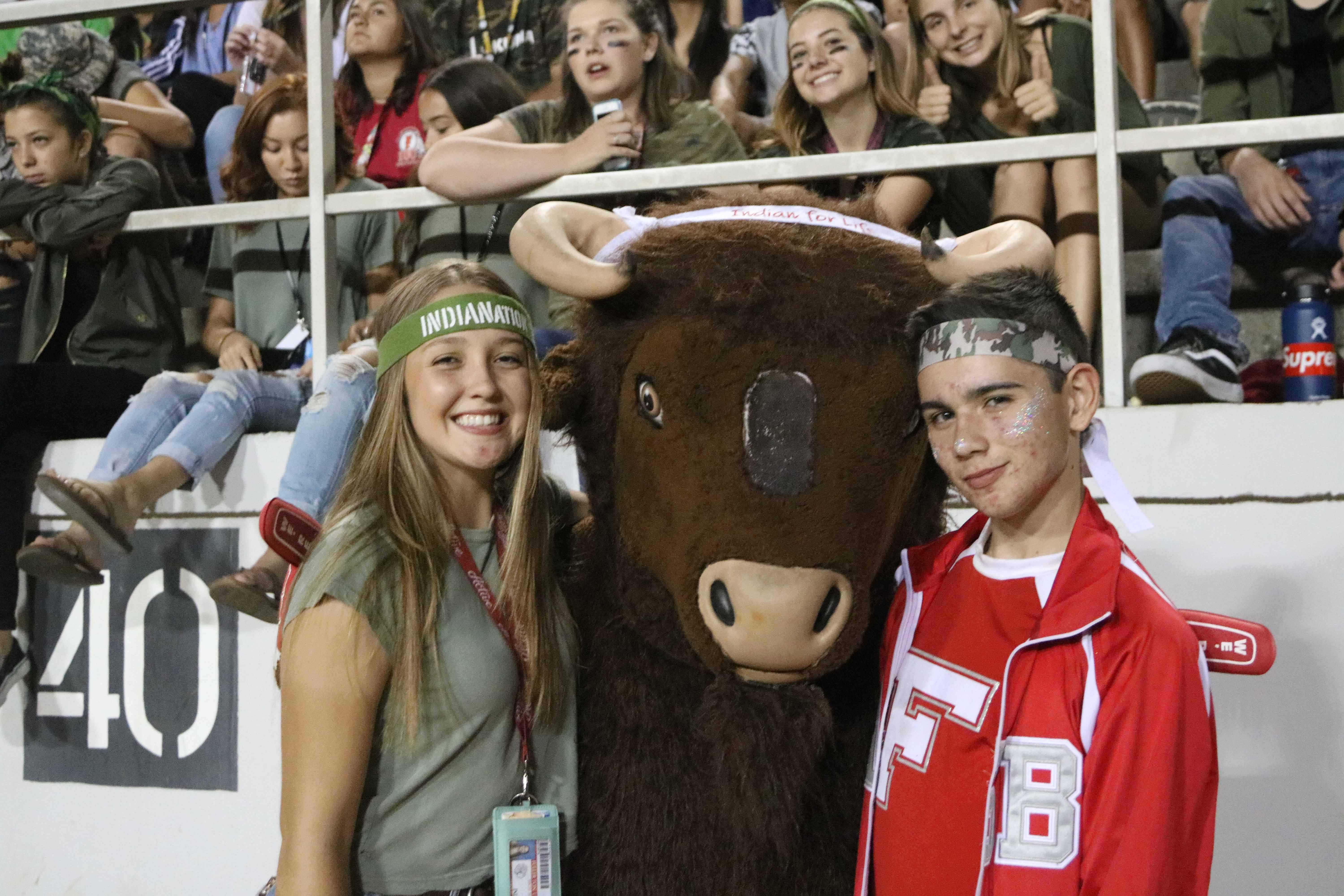 Sophomores+Claire+Wright+%28Left%29+and+Logan+Manjarres+%28Right%29+pose+with+the+school+mascot%2C+Willy+Ug+the+Bufflo.+Photo+by+Emily+Caluya