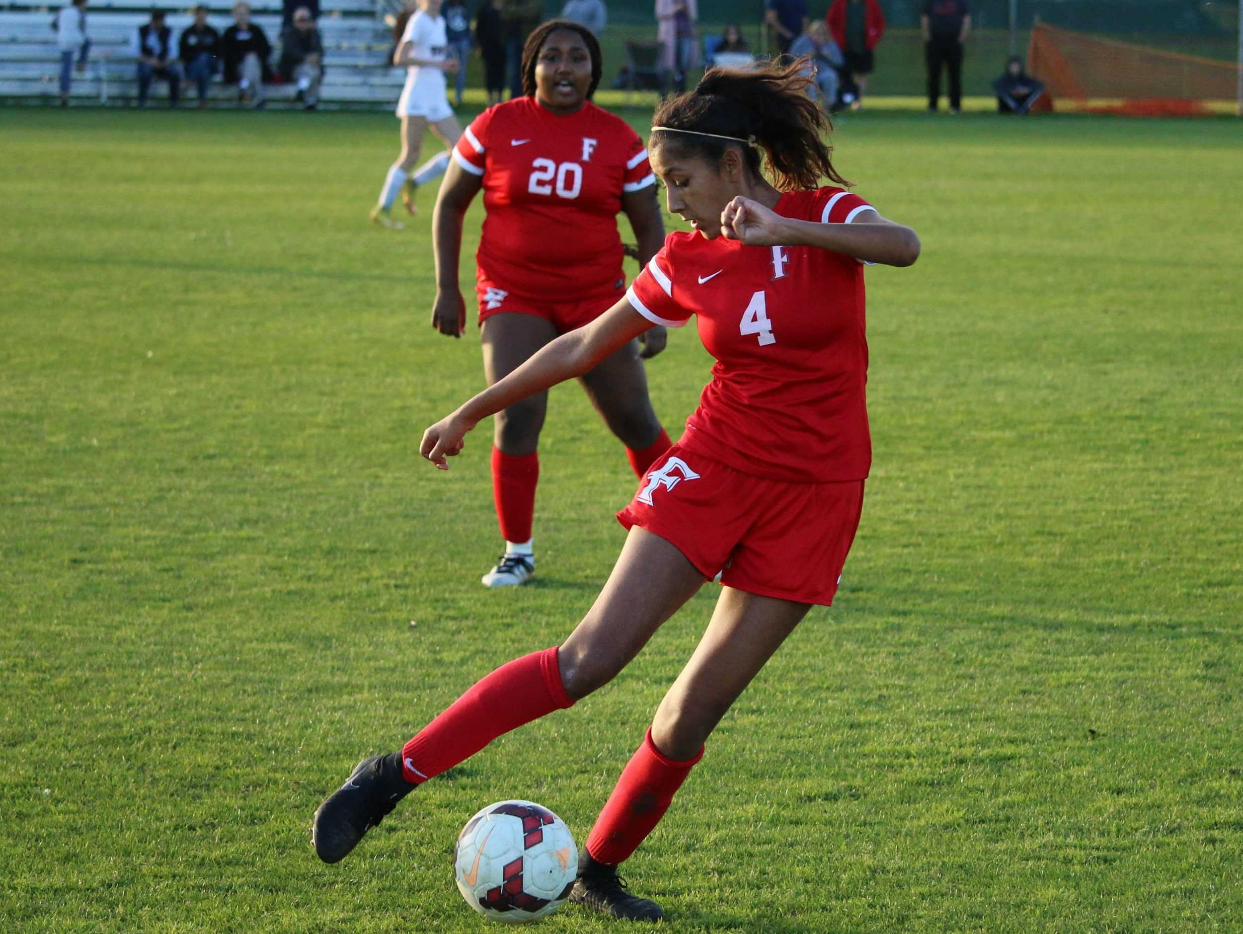 Sophomore Victoria Avina with the ball against Troy High School. Photo by Manuel Moreno.