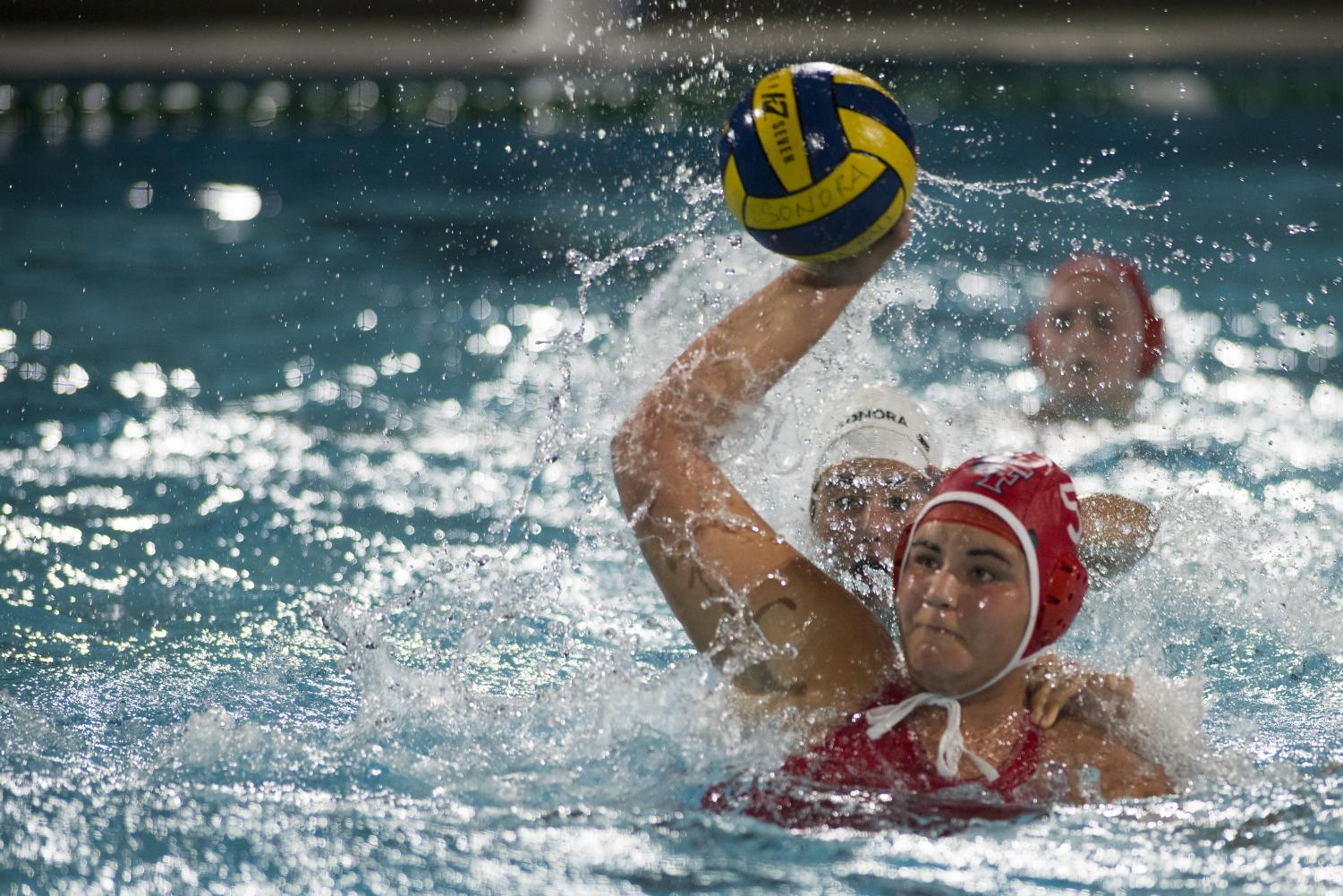 Senior Kaya Ortega passes the ball. Photo courtesy of Brian Crowe.
