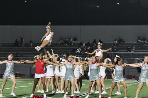 Varsity cheer starts with new spirit and coaches