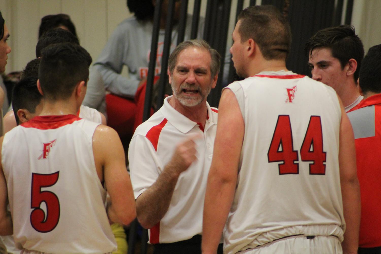 Coach Scott Sinek coaches his team during a timeout. Photo creds: Kylen Campbell