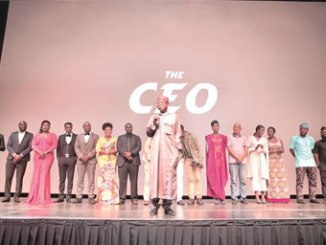 Minister of Information and Culture, Alhaji Lai Muhammed, with the cast and crew of 'The CEO' movie, last weekend.