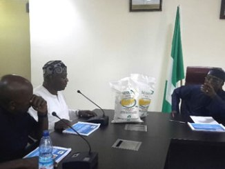 The National President, Association of Nigeria Cassava Growers, Segun Adewumi (left) making presentation to the Minister of Agriculture, Audu Ogbeh on many derivable benefits of cassava.