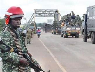 Ugandan forces cross a bridge in Elegu, Uganda just south of the border with South Sudan. PHOTO: Al Jazeera