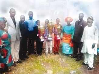 Pastor Ademola Fakunle (second left); Chief Examiner, Pastor Samuel Ogungbemi (third left); second overall winner, Akinola Feranmi of CAC, Ita-Baale Olugbode (fifth left); first overall winner, Marvelous Agboola of CAC, Oke-Ife, Agbowo (sixth left); third overall winner, Oluwaseun Lawal of CAC, Oke-Alafia, Loyola (fourth right); matron of the children association, Mrs Christie Ogunranti (third right); chairman of the children association, Pastor Gabriel Omosajuwa (second right); chairman, planning committee, Elder Akinsoji  (right) and others at the 45th children anniversary held at CAC, Olugbode, Ita-Baale, Ibadan, Oyo State, last Sunday.