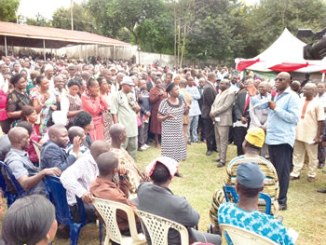 Governor Fayose (right), with a cross section of the teachers at the heated meeting. Photo: Sam Nwaoko.