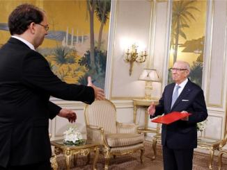 Tunisia's President Beji Caid Essebsi (Right) and the new Prime Minister designate, Youssef Chahed. PHOTO: EPA