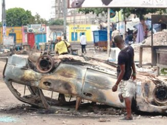 Protesters torched cars and built barricades during Monday's protests. PHOTO: AP