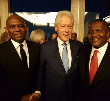 Former President of the United States, Bill Clinton, flanked  by President, Dangote group, Aliko Dangote (right) and Chairman, Heir Holdings, Tony Elumelu.