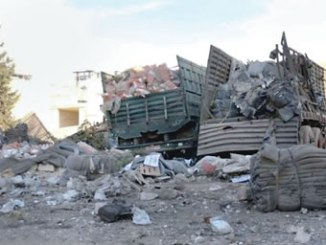 The attack on the convoy left aid supplies damaged beyond use and strewn over the ground. PHOTO: AP