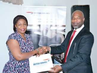 Faith Ikpobe, Managing Director, GEM Travels (left), receiving a prize from Ademola Adesanya, at the British Airways MD/CEO Trade Forum held in Lagos, recently.