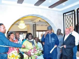 Executive Secretary, NCPC, Rev. Tor Uja cutting the tape to officially inaugurate the Nigerian Kitchen at Shepered Hotel in Bethlehem on his right is Mrs Berry Uja and the Charge d'Affairs, of the Embassy of Nigeria in Israel, Mrs  Frankie Obianagha.