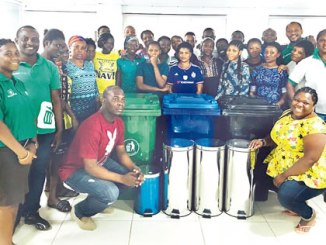 Janitorial staff of the First City Monument Bank (FCMB) Limited with the RecyclePoints' crew.
