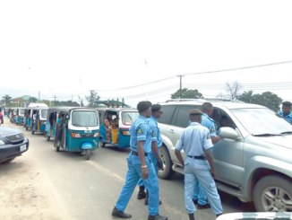 DESTMA officials scrutinising road users on contravening traffic laws opposite Urhobo College, Warri