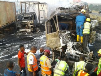 Road safety workers and other sympathisers inspecting the accident scene.