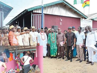 Chairman representing Ijaw ethnic nationality on the board of DESOPADEC, Chief Favour Izoukumor, and members of Kokodiagbene community, during the inauguration of the market. INSET: Trading ongoing in one of the market stalls.