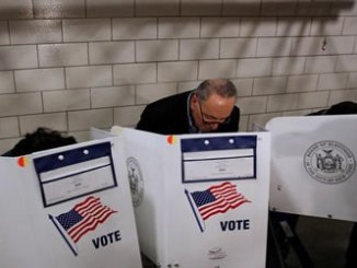 Senator Chuck Schumer fills out his ballot at PS 321 in Brooklyn. PHOTO: REUTERS.