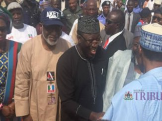 Minister of Solid Minerals, Dr Kayode Fayemi, supported by APC governorship candidate in Ondo, Rotimi Akeredolu, welcoming President Muhammadu Buhari to Ondo APC mega rally, on Saturday.