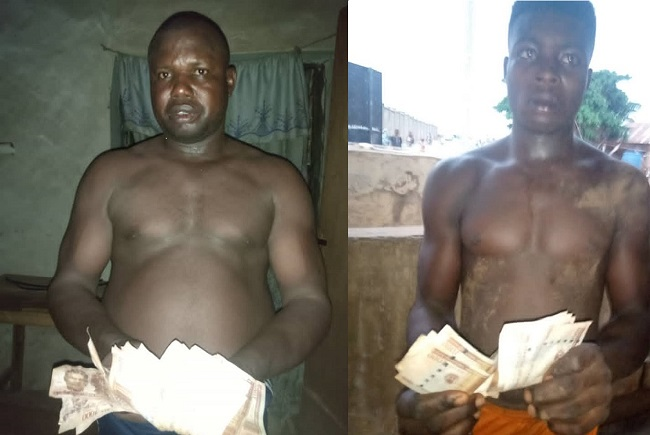 Two arrested for buying