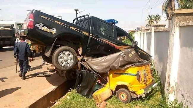 Escort vehicle crushes tricycle passengers