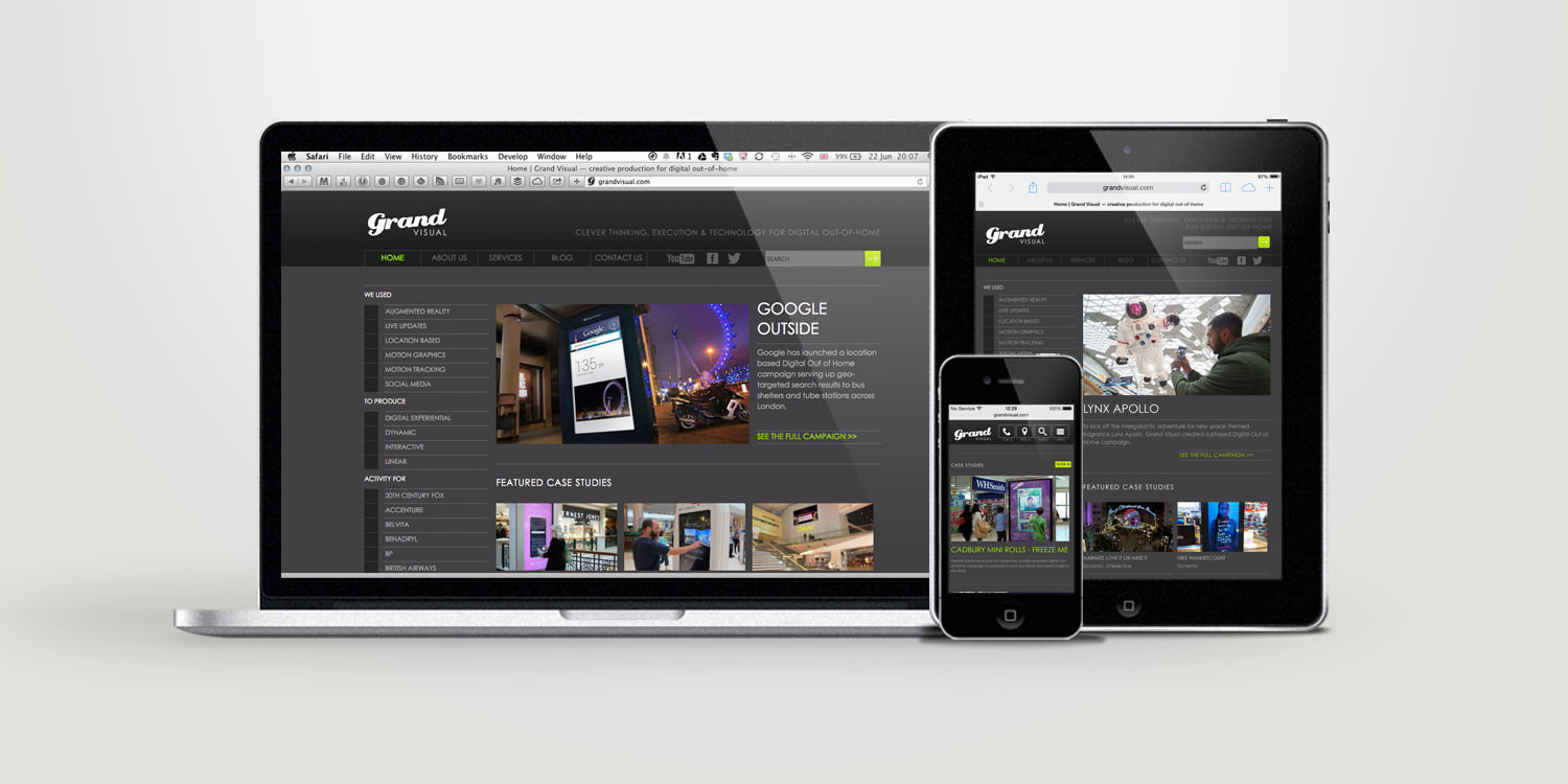 The Grand Visual website homepage as displayed on laptop and mobile devices