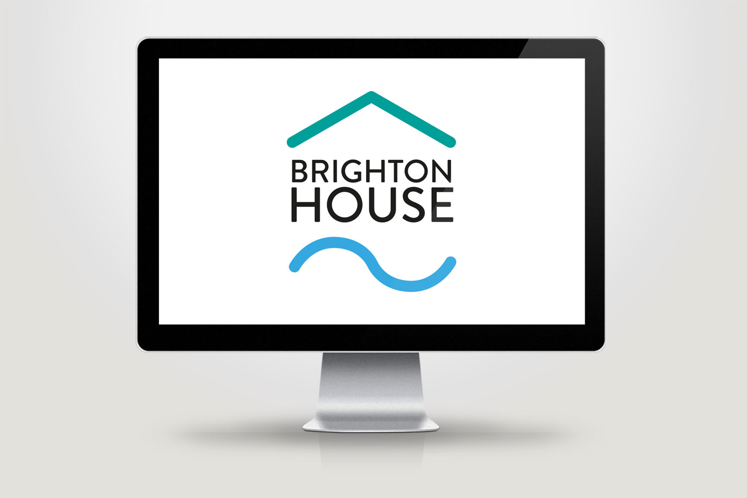 An iMac with the final version of the Brighton House brand identity – Tribus Creative, brand identity design for small business