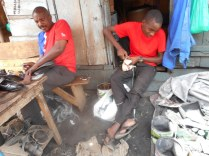 Amanaya helps his father repair shoes.
