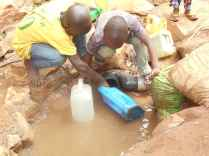 Ivan and Yoweri fetch water