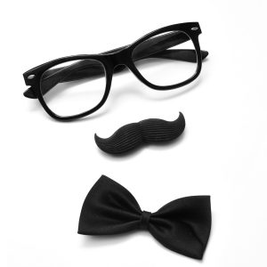 a pair of glasses, a mustache and a bowtie on a white background