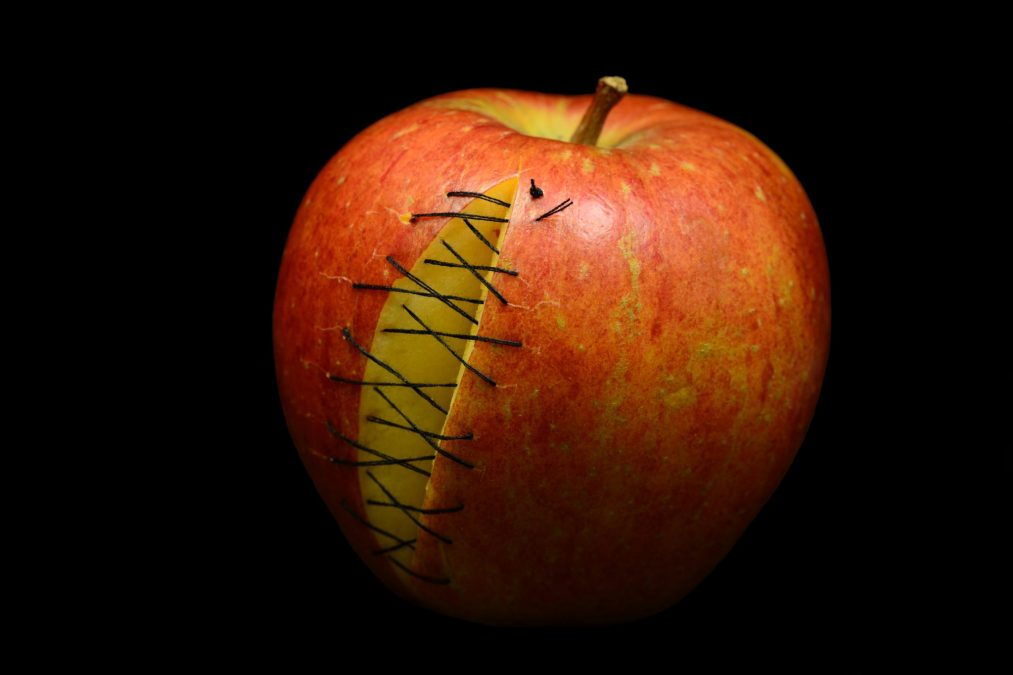 Red apple with scars