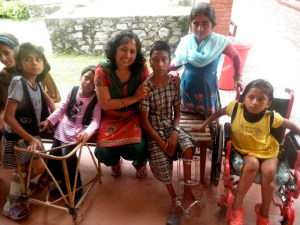 House-Mom, Shanti with Naina and other children from DNC - Disabled Newlife Center- Kathmandu, Nepal