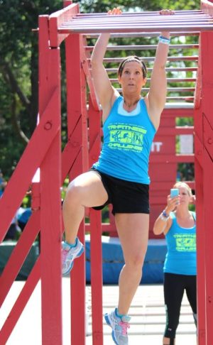 Sisters Athletes Moms - Blondina Polazzo who achieved success at the 2015 Tri-Fitness World Challenge, climbs across the Monkey bars.