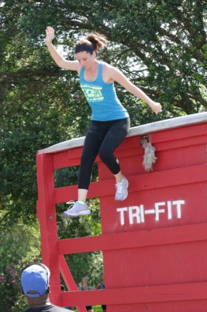 Athletes Moms - Tracy Goodwin (Tennessee) who achieved success at the 2015 Tri-Fitness World Challenge, climbs over the 10 foot wall.