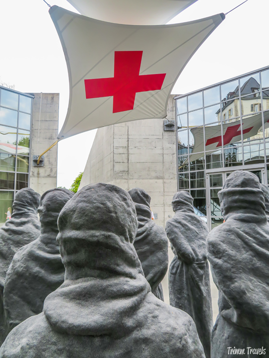 Victims' Statue and Red Cross Flag Geneva