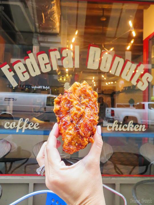piece of sweet soy garlic glazed friend chicken at Federal Donuts- unique restaurants philadelphia