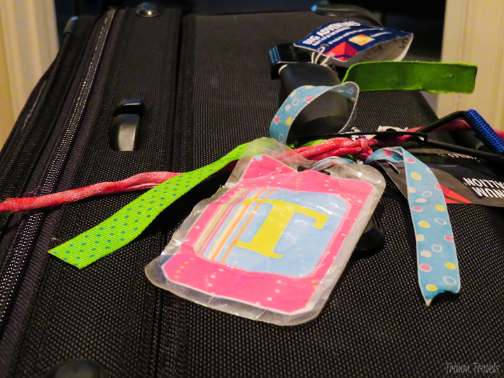 closeup ribbons and luggage tag-tips for easy packing process