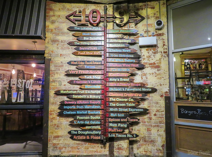unique colorful wooden sign with store listings in Chelsea Market in New York City