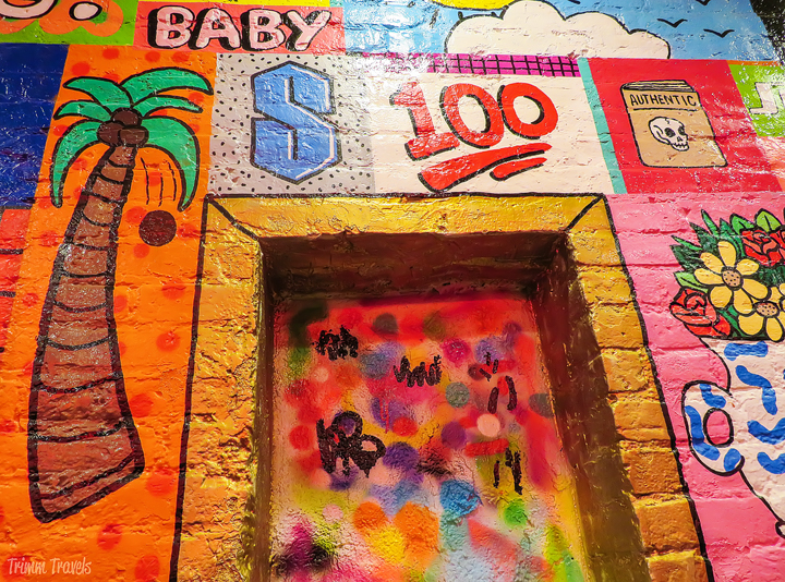 colorful murals inside Sticky's Finger Joint in New York City