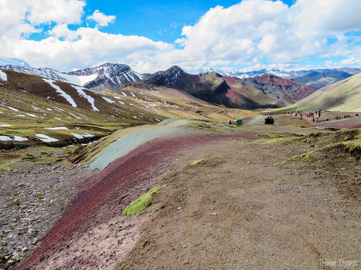 on the way back down from Rainbow Mountain Peru with minerals showing vibrant colors in the ground