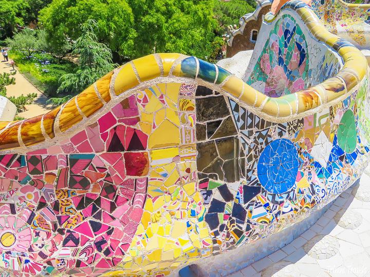 scalloped, colorful mosaic wall at Park Güell A Gaudi Barcelona Tour