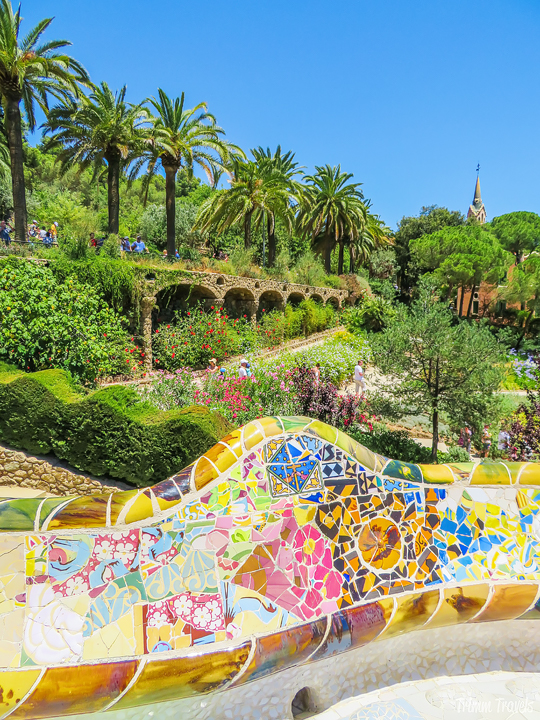 scalloped mosaic wall and gardens at Park Güell A Gaudi Barcelona Tour