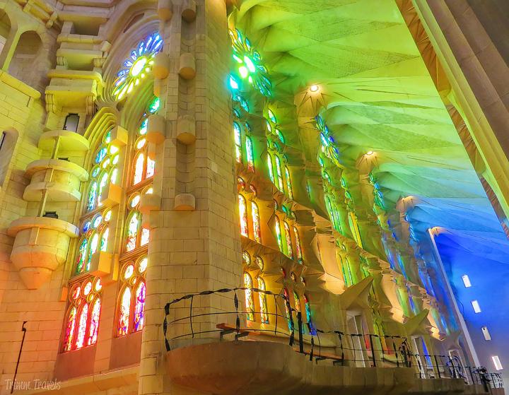 sun shining powerfully through the stained glass windows in La Sagrada Familia A Gaudi Barcelona Tour