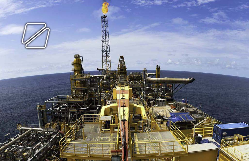 Wide angle fisheye view of a large FPSO type oil rig.