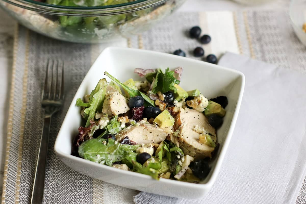 Keto Avocado Chicken Salad With Blueberries in white bowl