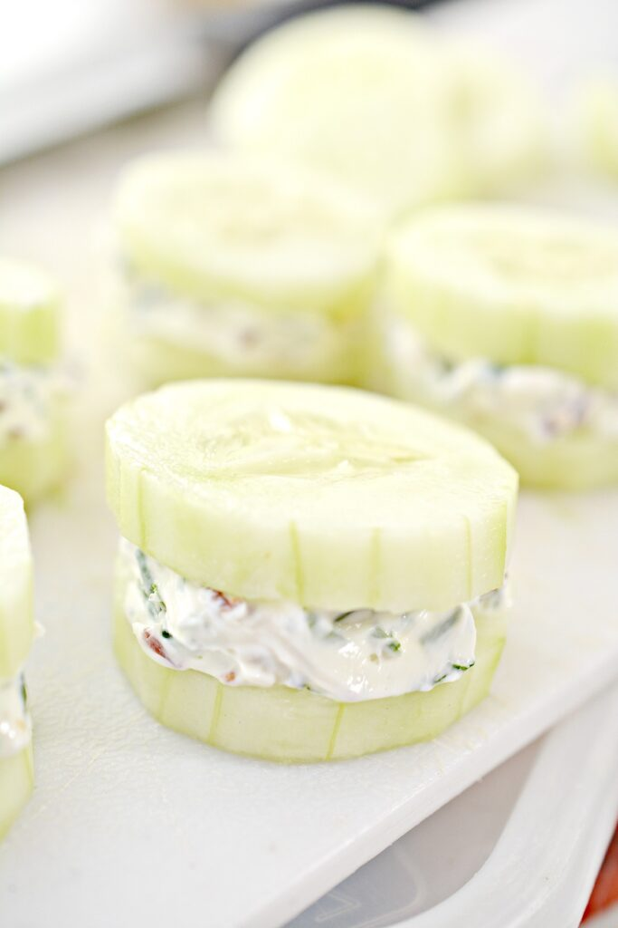 Bacon Herbed Cream Cheese Cucumber Bites on white plate