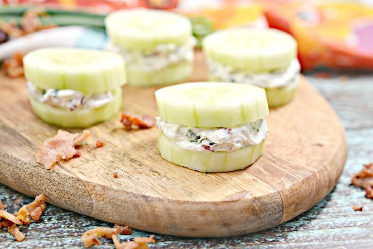 Bacon Herbed Cream Cheese Cucumber Bites on cutting board