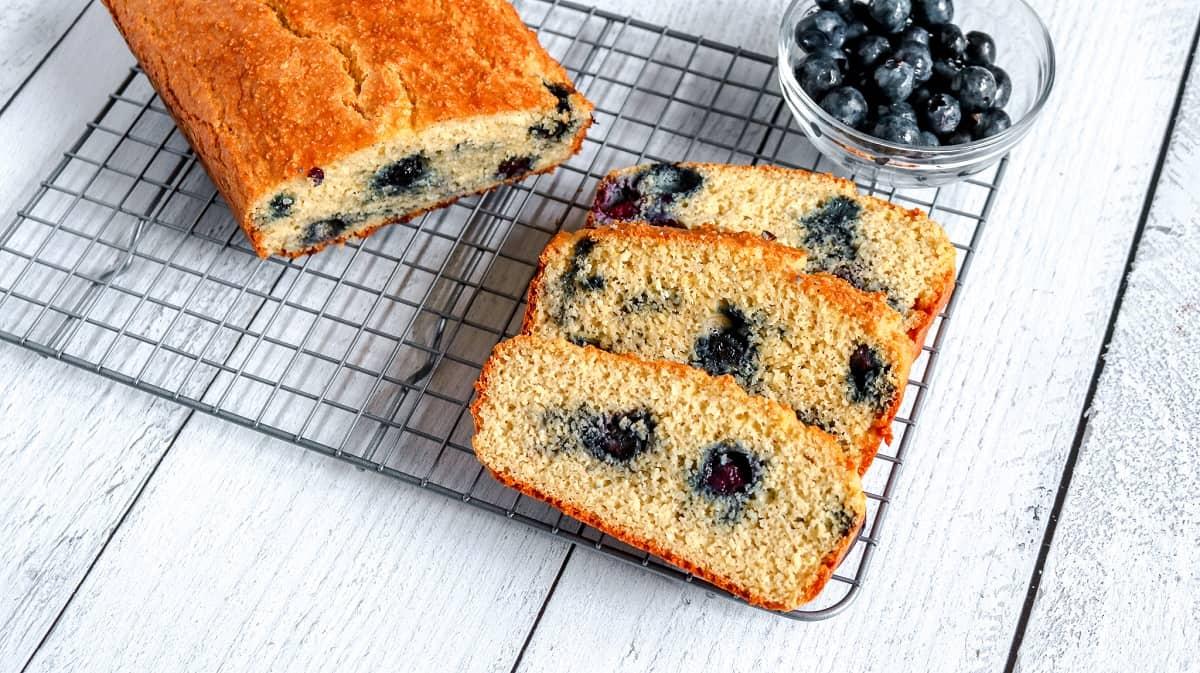 Keto Blueberry Bread sliced on wire rack