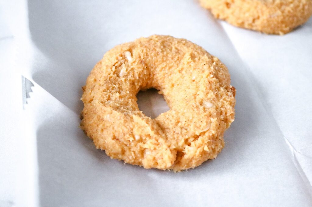 Keto Pumpkin Pecan Bagels on baking sheet