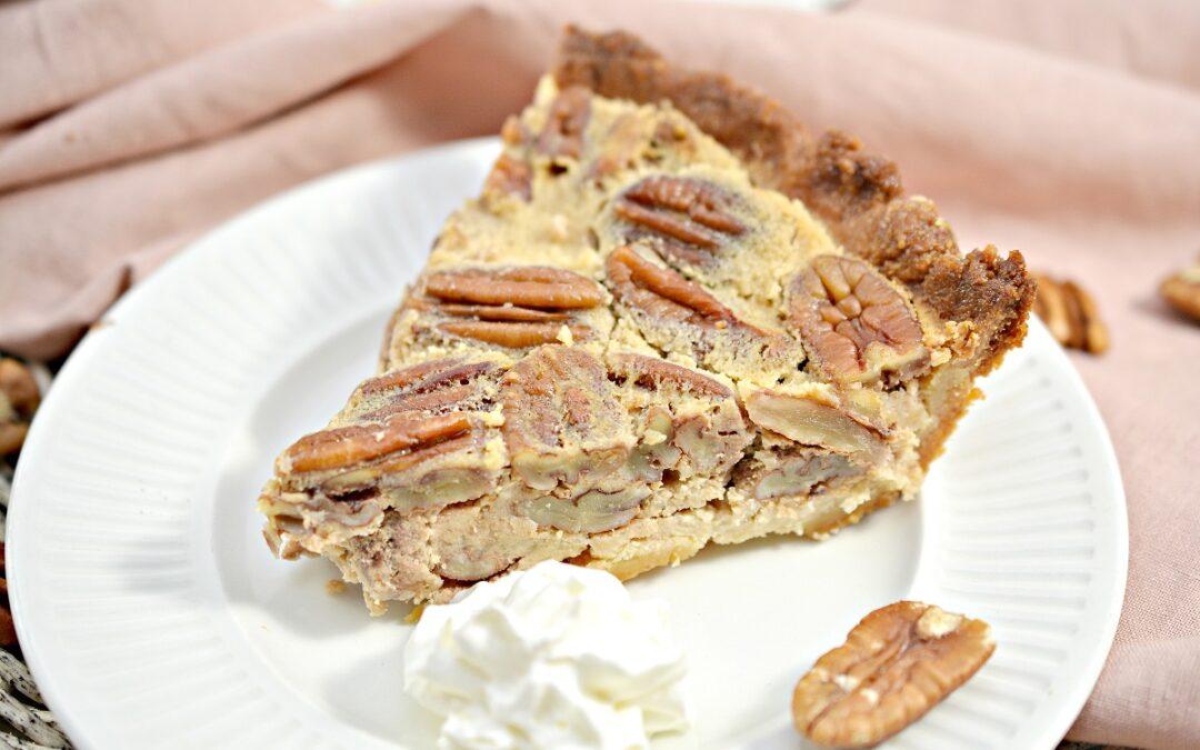 Keto Pecan Pie slice on white plate