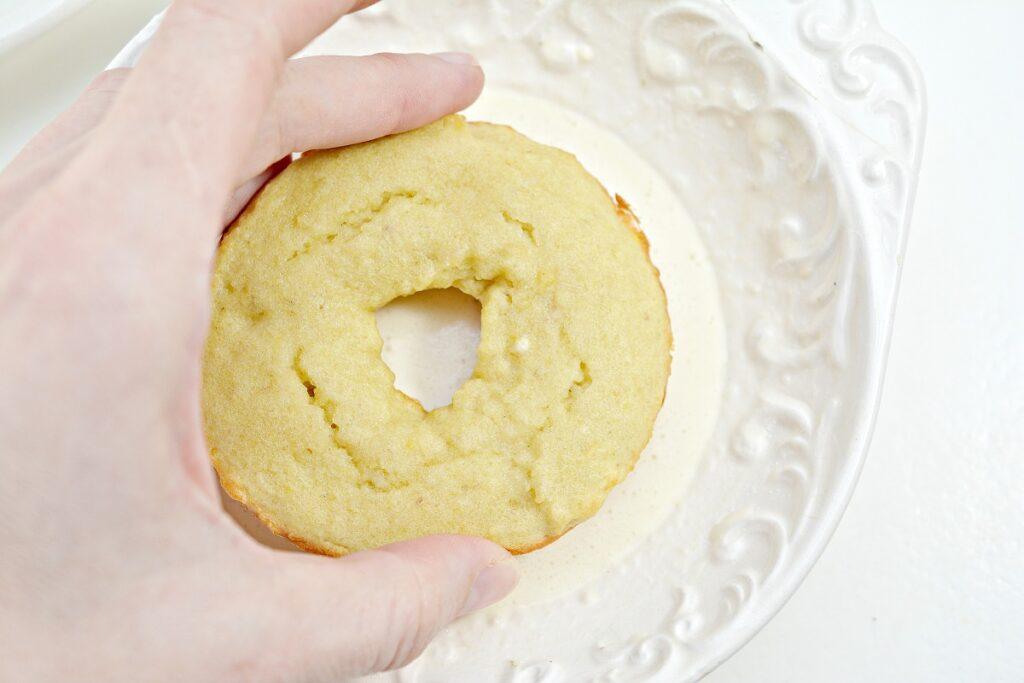 Dipping donut in glaze